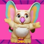 Kowl's coloring is a very light yellow with turquoise, orange, and pink ears and a white belly. He did not come with any accessories.