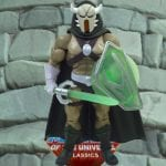 Lord Masque action figure from the Masters of the Universe Classics line. Find other figures, weapons, vehicles, and accessories using the Weapons Rack.